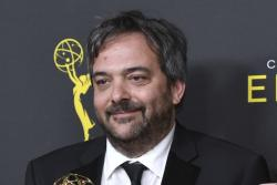"""Adam Schlesinger, winner of the awards for outstanding original music and lyrics for """"Crazy Ex Girlfriend,"""" in the press room at the Creative Arts Emmy Awards in Los Angeles."""