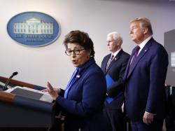 In this Thursday, April 2, 2020 file photo, Jovita Carranza, administrator of the Small Business Administration, speaks about the coronavirus in the James Brady Press Briefing Room of the White House in Washington, as Vice President Mike Pence, President Donald Trump listen