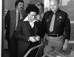 This Feb. 23, 1982 file photo shows Wayne B. Williams leaving the Fulton County Jail in Atlanta to go to court where he will continue testifying in his trial on charges of killing two black children in Atlanta