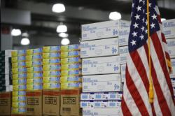 In this March 24, 2020, file photo stacks of medical supplies are housed at the Jacob Javits Center that will become a temporary hospital in response to the COVID-19 outbreak in New York