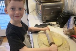 This March 22, 2020, photo released by Alexandra Nicholson shows her son, Henry Martinsen, making food in Quincy, Mass.
