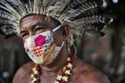 In this May 10, 2020 photo, Pedro dos Santos, the leader of a community named Park of Indigenous Nations, poses for a photo, in Manaus, Brazil.