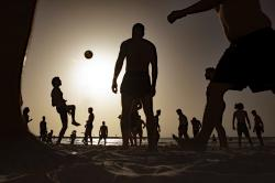 People enjoy the beach front in Tel Aviv, Israel, Wednesday, May 20, 2020