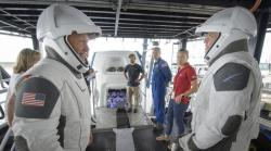 In this Aug. 13, 2019 file photo, NASA astronauts Doug Hurley, left, and Bob Behnken work with teams from NASA and SpaceX to rehearse crew extraction from SpaceX's Crew Dragon, which will be used to carry humans to the International Space Station, at the Trident Basin in Cape Canaveral, Fla.