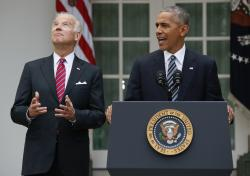 Vice President Joe Biden, left, looks upwards while listening to President Barack Obama speak in the Rose Garden of the White House.
