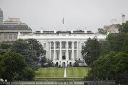 An American flag flies at half-staff above the White House in Washington.