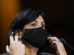 Dr. Rochelle Walensky, director of the Centers for Disease Control and Prevention, adjusts her face mask during a Senate Health, Education, Labor and Pensions Committee hearing on the federal coronavirus response on Capitol Hill in Washington, in this Thursday, March 18, 2021, file photo