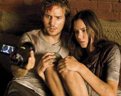 "Michael Stahl-David and Odette Yustman in ""Cloverfield"""