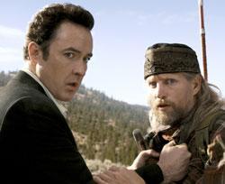 "John Cusack and Woody Harrelson in ""2012"""