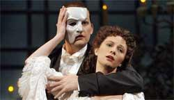 Tim Martin Gleason as the Phantom and Trista Moldovan as Christine Daaé in The Phantom of the Opera.