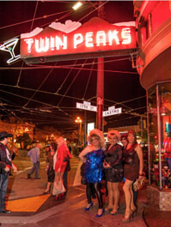 A drag trio of Twin Peaks fans outside the historic bar