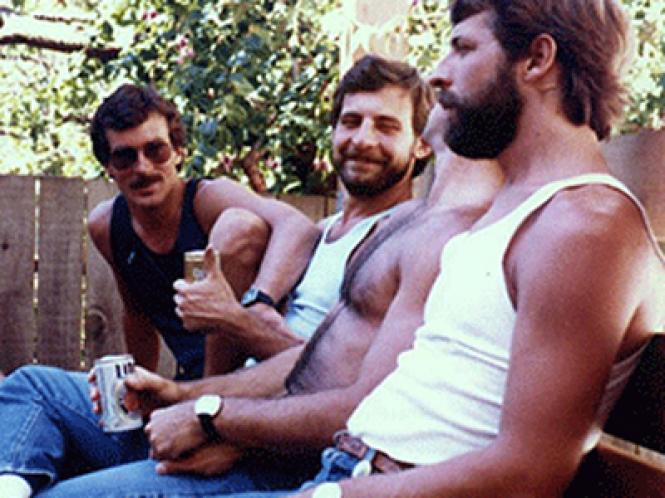 Mark Abramson (center) with friends at a back yard gathering in the Castro, his 28th birthday garden party in 1980.