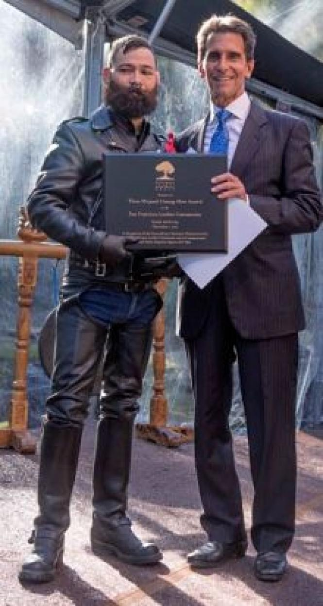 Jorge Vieto Jr. (left) with State Senator Mark Leno (right) as Jorge accepts the Thom Weyand Unsung Hero Award on behalf of the entire San Francisco leather community