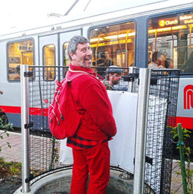 Artist Jokie X Wilson demonstrates the new pissoir at Mission Dolores Park