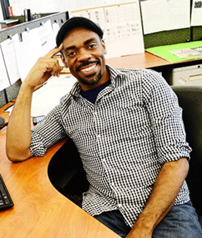 SF Weekly editor Channing Joseph sits at his desk at the paper's Market Street offices