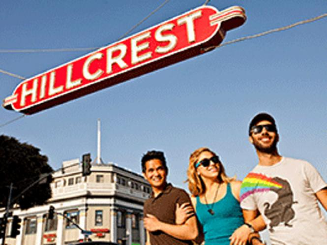 Visitors walk under the Hillcrest sign in San Diego's gayborhood. Photo: San Diego Travel Blog/SanDiego.org
