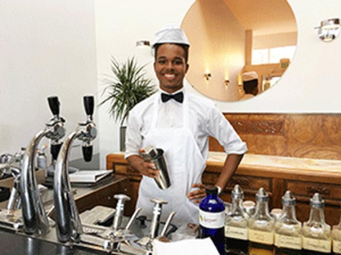 Jamal Hargrove prepares a sweet soda at The Castro Fountain