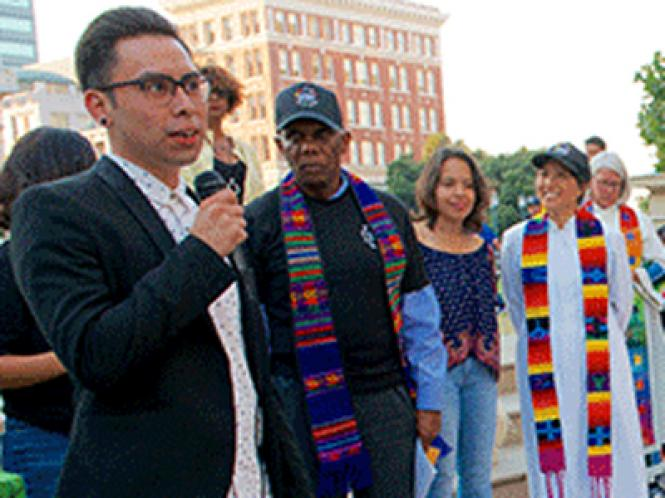 Gerardo Gomez, left, a gay man and DACA Dream Fellow at Pangea Legal Services SF, addressed a crowd of 100 in Oakland August 31 days before President Donald Trump ended the Deferred Action for Childhood Arrivals program