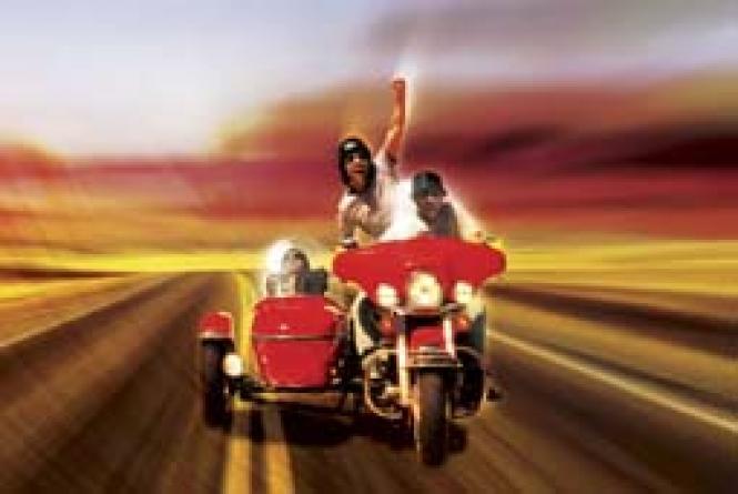 Ami Ankilewitz gets a ride on a Harley.