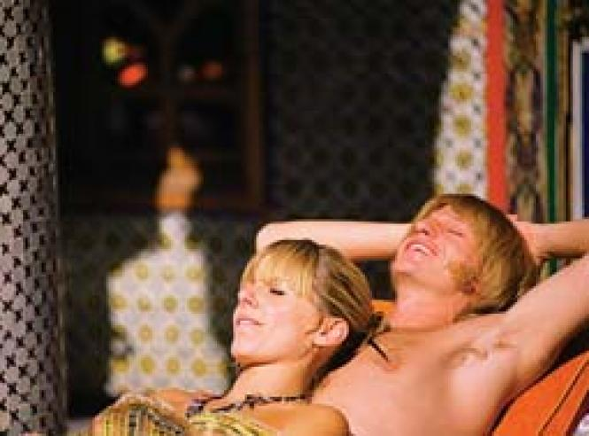 Brian Jones (Leo Gregory) and Anita share a moment in <i>Stoned.</i><br>