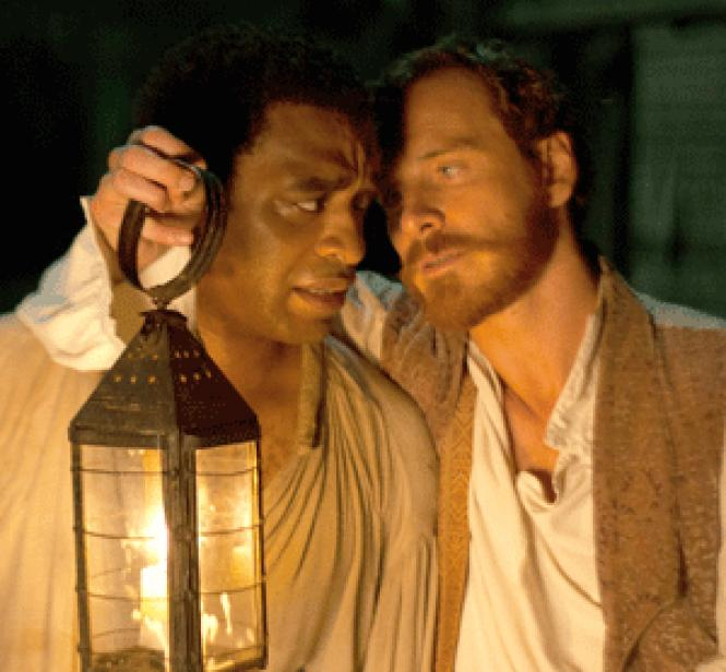 Chiwetel Ejifor and Michael Fassbender in director Steve<br>McQueen's <i>12 Years a Slave.</i>