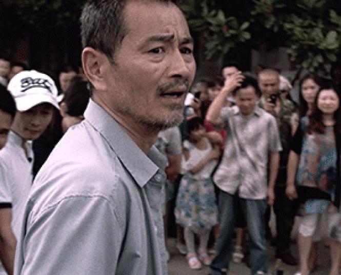 Chen Gang as taxi driver Lao Shi in director Johnny Ma's <i>Old<br>Stone.</i> Photo: Zeitgeist Films