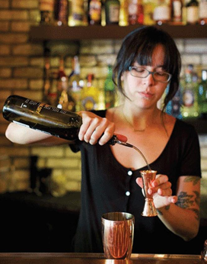 Claire Sprowse of Tin Roof Drink Community creates a<br>holiday cocktail.