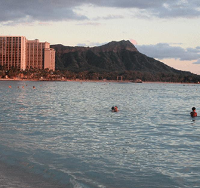 Sunset on Waikiki Beach, with Diamond Head in the<br>background. Photo: Ed Walsh