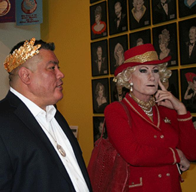 John Carrillo, left, chairman of the Imperial Council of<br>San Francisco, and former Empress Donna Sachet stand in front of paintings of<br>past emperors and empresses that are part of the new exhibit, &quot;Over the<br>Top: Math Bass and the Imperial Court SF&quot; now at the Oakland Museum of<br>California. Photo: Michael Nugent
