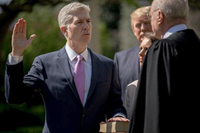 Judge Neil Gorsuch was sworn in Monday by Supreme Court<br>Justice Anthony Kennedy. Photo: Courtesy NPR