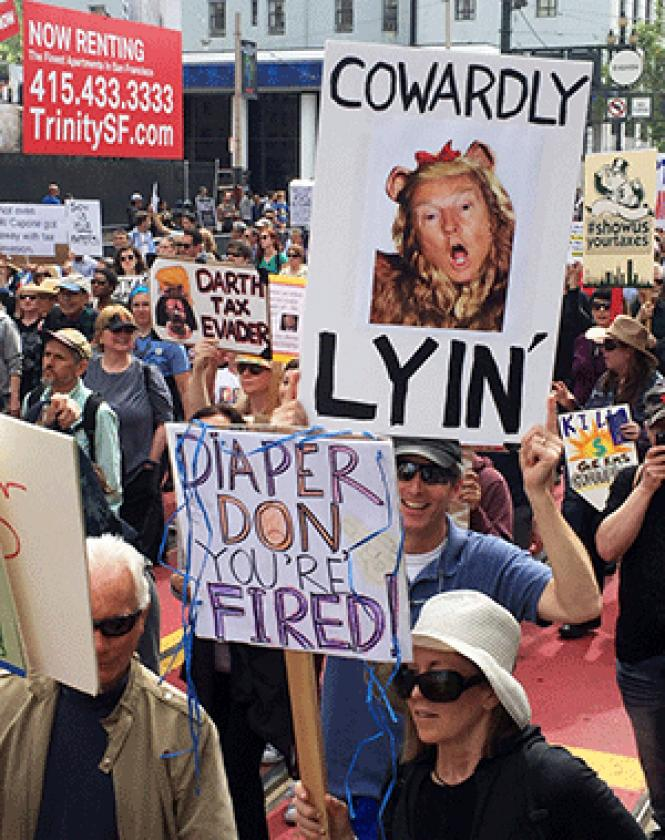 The April 15 Tax March in San Francisco drew a crowd,<br>with many participants carrying humorous signs. Photo: Liz Highleyman