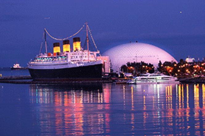 The Queen Mary, a floating hotel and event and wedding<br>venue, is beautifully lit at night. Photo: Courtesy Long Beach Area Convention<br>and Visitors Bureau