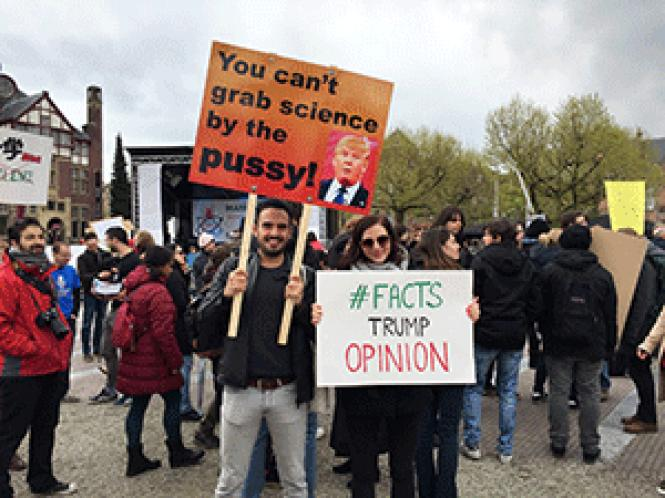 Protesters held signs at the March for Science in<br>Amsterdam. Photo: Liz Highleyman
