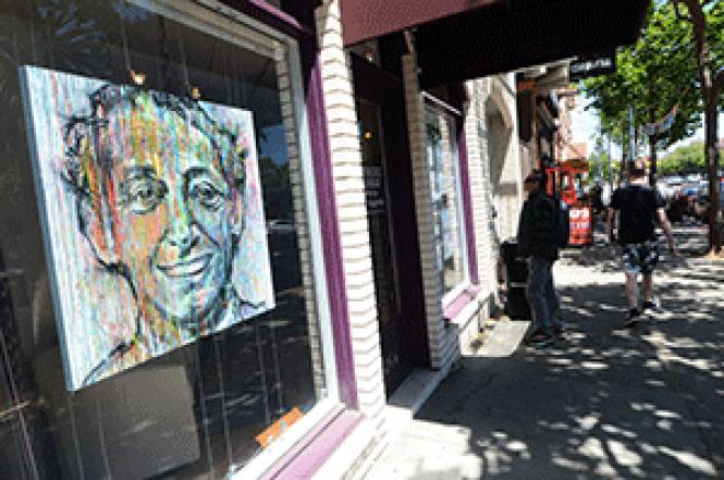 As part of the Windows for Harvey initiative, the<br>Berkshire Hathaway-Drysdale Properties office has a painting of Harvey Milk by<br>Jun Yang in its Market Street office window. Photo: Rick Gerharter