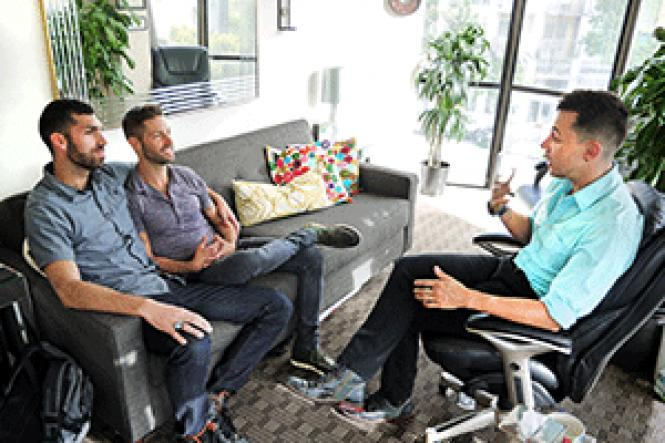 Queer couples therapist Brendan Neff-Hall, right,<br>provides counseling to a gay couple. Photo: Courtesy Queer Couples Center