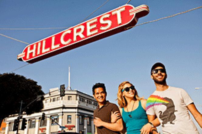 Visitors walk under the Hillcrest sign in San Diego&#039;s<br>gayborhood. Photo: San Diego Travel Blog/SanDiego.org