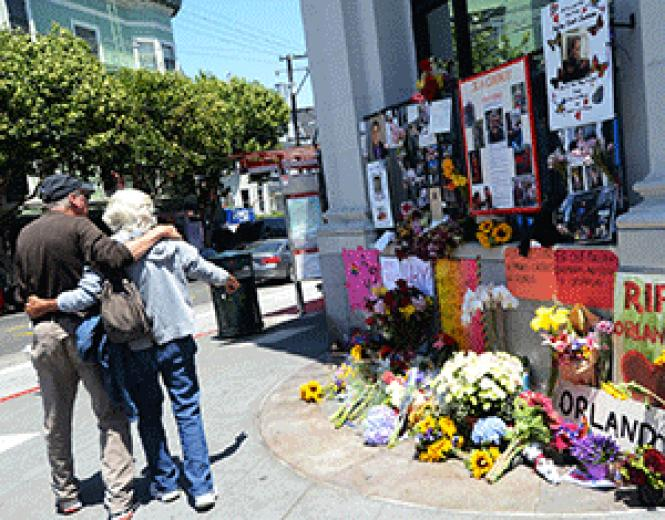 People walked by a memorial for the Pulse nightclub<br>victims at 18th and Castro streets June 12, 2016, shortly after news spread of<br>the mass shooting. Photo: Rick Gerharter