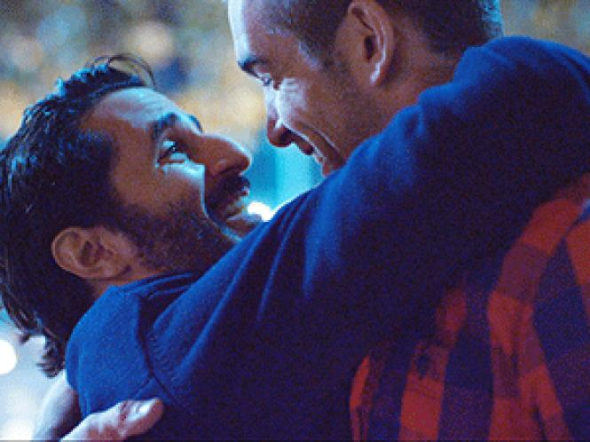 Gay lovers embrace in a scene from &quot;Breaking<br>Fast.&quot; Photo: Courtesy AFMI