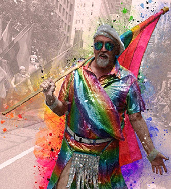 Rainbow flag creator Gilbert Baker marched down Market Street during the June 28, 2015 San Francisco LGBT Pride parade. Photo: Rick Gerharter