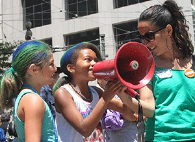 Renata Moreira helps hold a bullhorn for kids at the 2012<br>San Francisco Pride parade. Photo: Our Family Coalition
