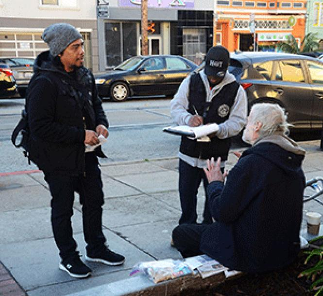 Homeless Outreach Team members Charles Garcia, left, and<br>Elester Hubbard offered assistance to a man sitting on a Castro district<br>sidewalk in this 2016 file photo. Photo: Rick Gerharter
