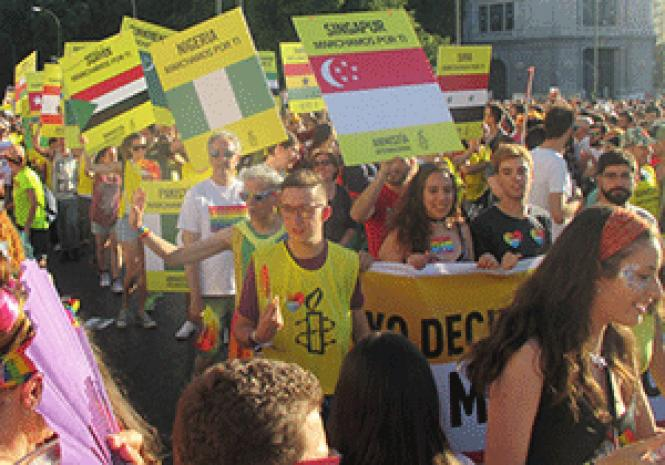 Amnesty International&#039;s contingent marched in the<br>WorldPride parade July 1 in Madrid. Photo: Ed Walsh&nbsp;<br><br><br><br><br><br><br>