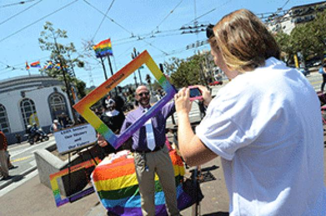 Natalie Summers from Openhouse, right, took a photo of<br>Sister Rose Mary Chicken and E.J. Hebert in Jane Warner Plaza in May as part of<br>a project that asked federal officials not to remove LGBT elders from the<br>National Survey of Older Americans. Photo: Rick Gerharter