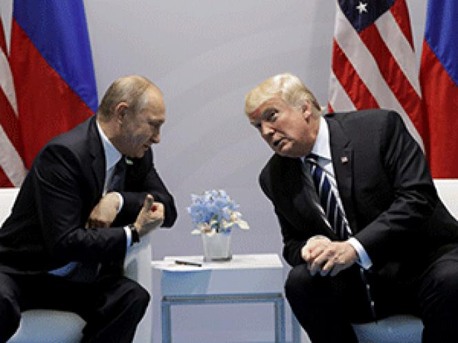 Russian President Vladimir Putin, left, and President<br>Donald Trump met for the first time July 7 on the sidelines at the G-20 summit.<br>Photo: AP