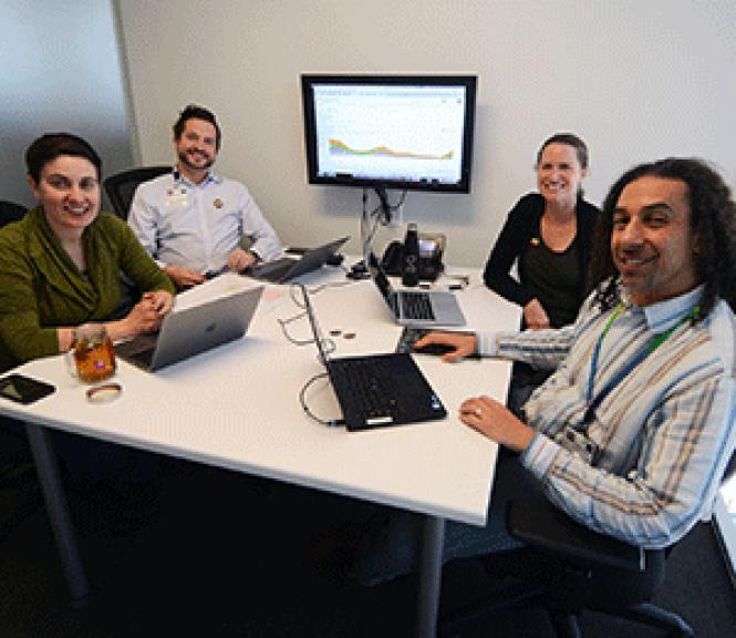 The leadership team of the PRIDE Study, Dr. Juno<br>Obedin-Maliver, left, Mitchell Lunn, Carolyn Hunt, and Micah Lubensky met<br>recently to discuss the project&#039;s progress. Photo: Rick Gerharter
