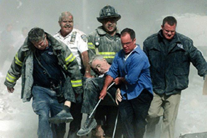 The body of Father Mychal Judge is taken from the World<br>Trade Center on September 11, 2001. Photo: Shannon Stapleton/Reuters