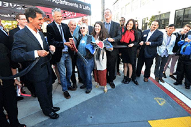 Dignitaries including former state Senator Mark Leno, left,developer Amir Massih, San Francisco Planning Director John Rahaim, GayleRubin, supervisorial aide Sunny Angulo, and developer Tony Deplisse cut theribbon to officially dedicate the improvements to Ringold Alley that honor theleather history of the South of Market area. Photo: Rick Gerharter