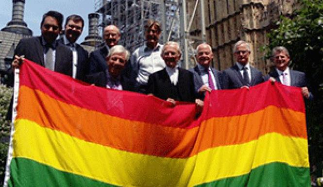 Members of the British Parliament hold the rainbow flag<br>in front of Westminster Palace in support of LGBT rights. Photo: BBC