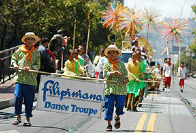 A dance group marched in last year&#039;s Pistahan parade.<br>Photo: Courtesy FAAE