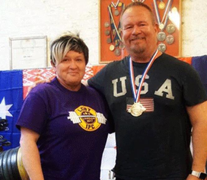 At the inaugural LGBT International Powerlifting<br>Championships in London Ben Gilliam, right, received his gold medal from<br>presenter Hanne Bingle Mbe. Photo: Dave McWilliam